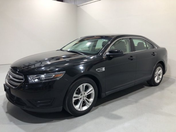 Used 2015 Ford Taurus for sale in Houston TX.  We Finance!
