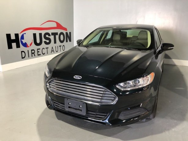 Used 2014 Ford Fusion for sale in Houston TX.  We Finance!