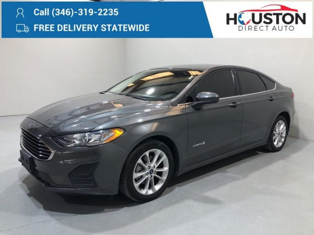 Used 2019 Ford Fusion Hybrid for sale in Houston TX.  We Finance!